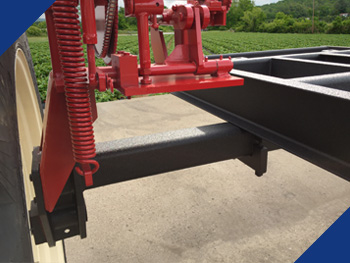 Fabick coating applied to a wheel track spreader.