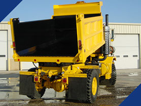 A airport dump truck coated with a Fabick Poured-On® Liner.