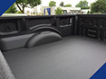 A bed of a pickup truck coated with Fabick's The Heavyweight® Liner product.