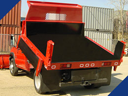 A Fabick aromatic polyurethane coating applied to the dump bed of a city municipality truck.