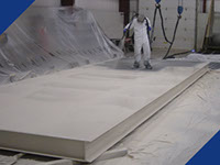 A Fabick industrial coating being applied to an industrial piece of equipment.